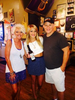 Veronica Ballestrini with Beth and Rick owners of Rick's Smokehouse and Grill in Terre Haute, IN with WTHI 99