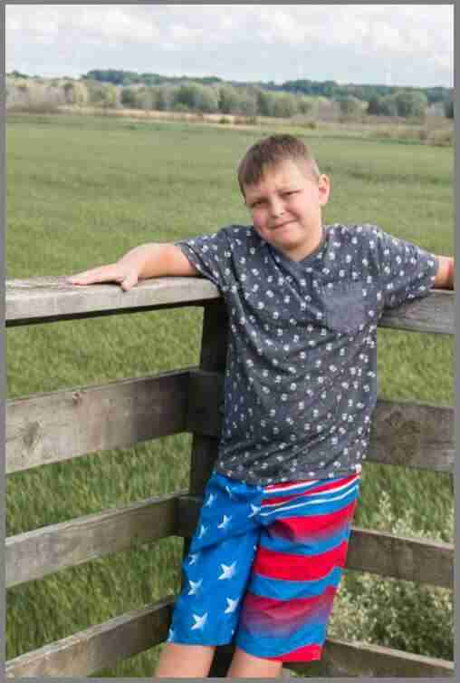 boy with arm cropped off breaking rules for cropping photos