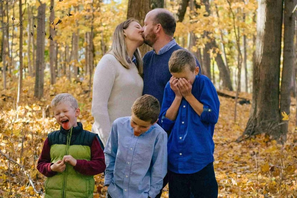 Parents kissing with kids making ew faces