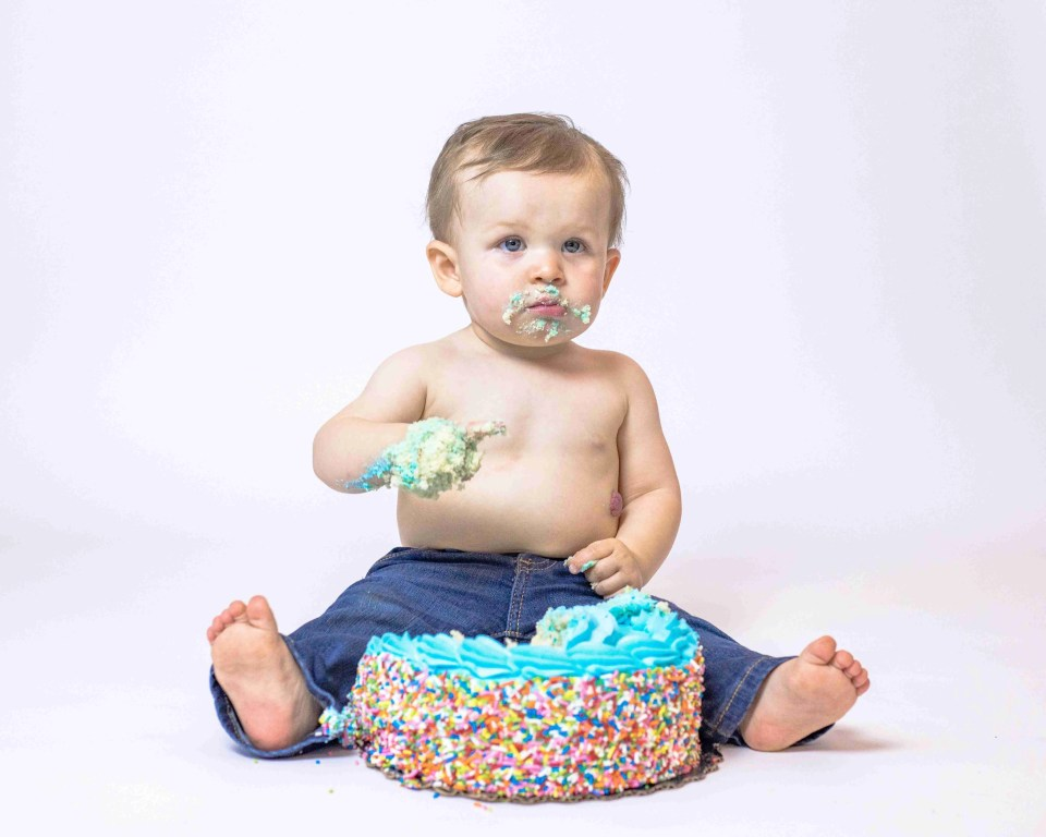 Baby with a birthday cake - not blurry