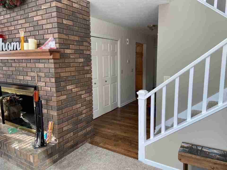 hallway with fireplace and stairwell