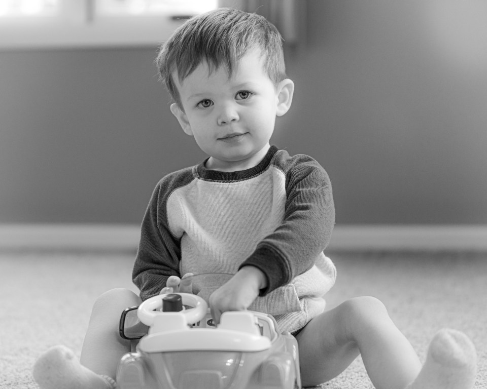 black and white photo of a toddler with a car from sassy grandparent name blog post