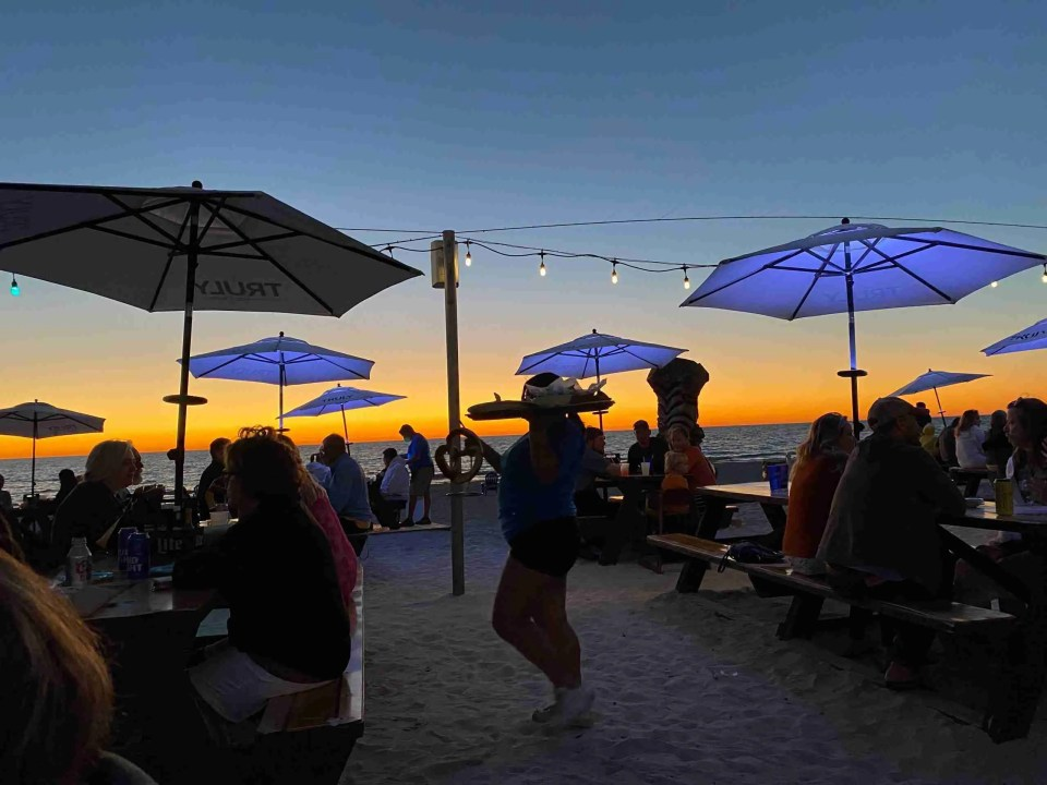 The beginning of blue hour at Caddy's Beachfront Restaurant - one of the top places to eat in St Pete