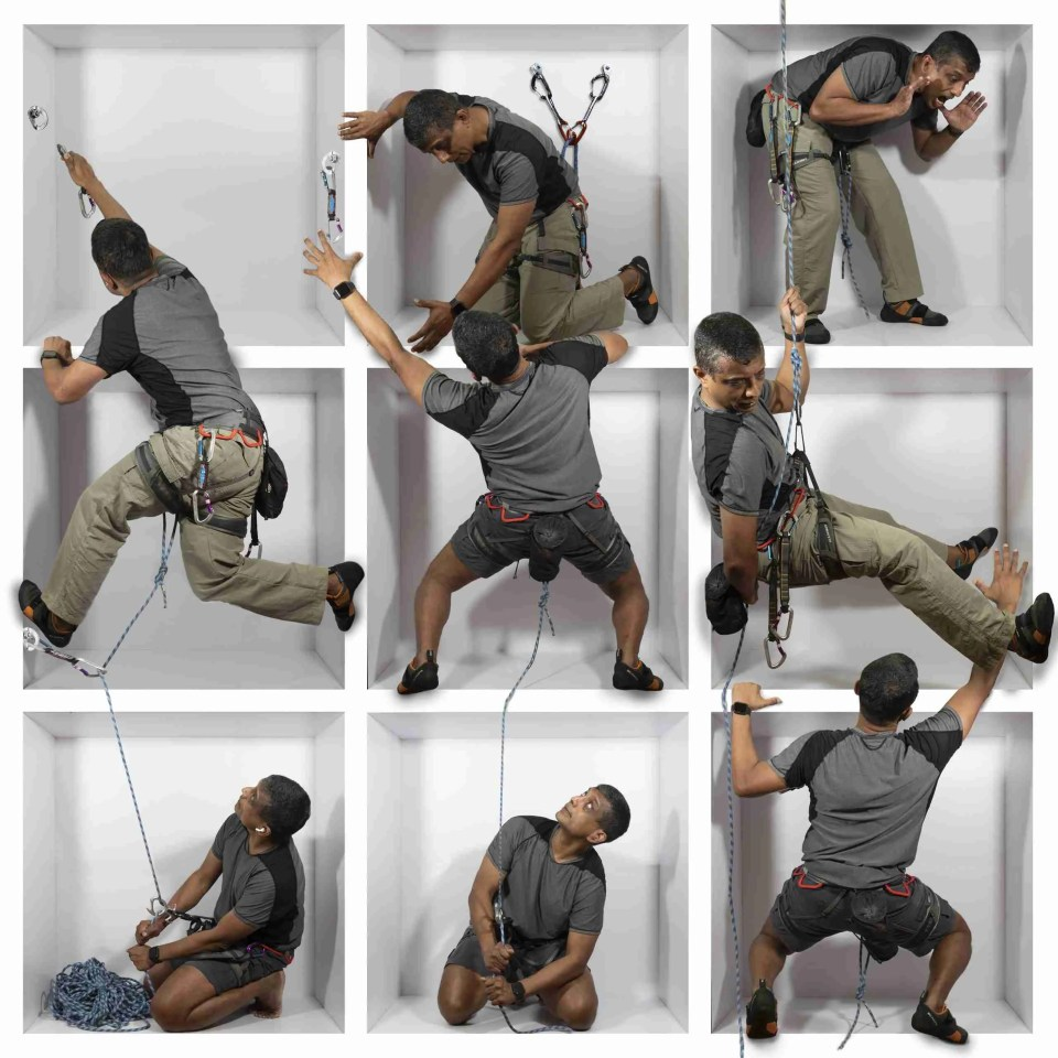 a man rappeling in and out of boxes in a creative in-the-box photography composite
