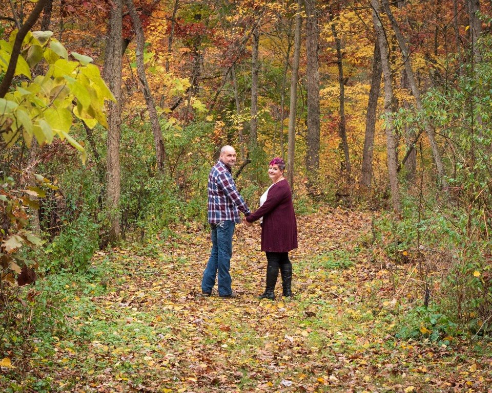 Autumn photoshoot with a couple walking down a path