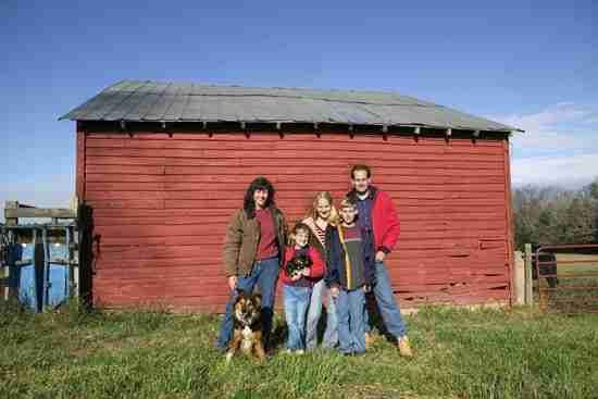 autumn photoshoot family in front of red barn