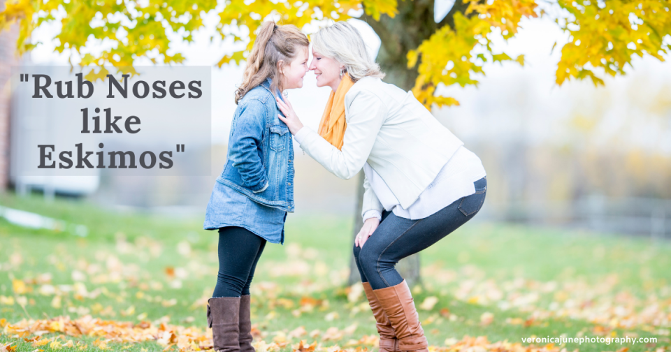 a mom and daughter rub noses in front of a fall tree showing how a photo prompt works