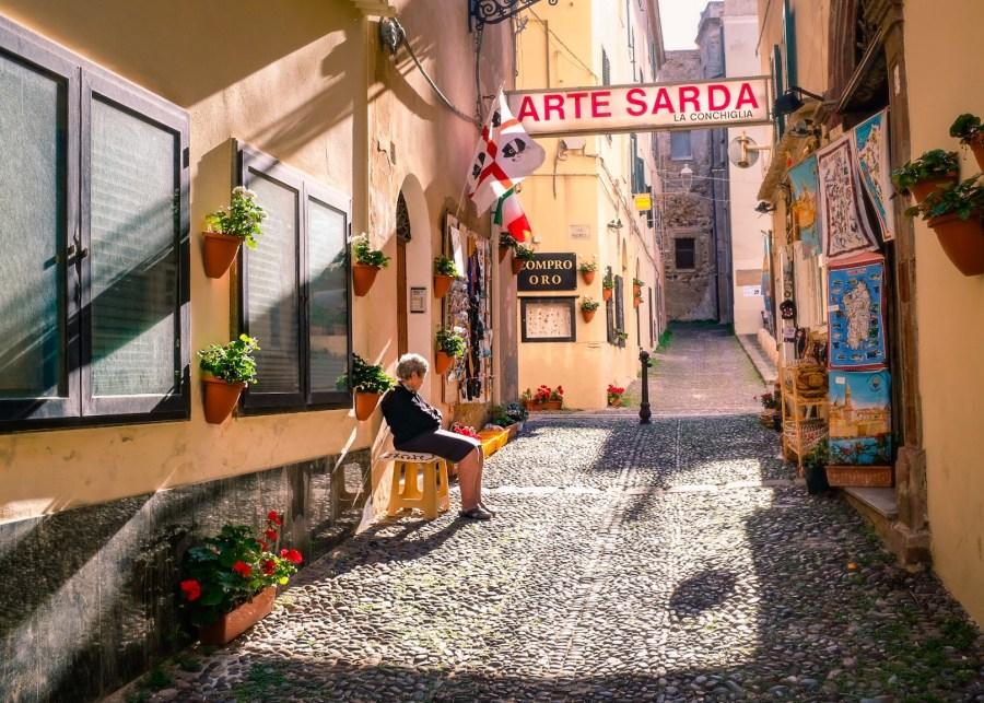 old_lady_sitting_alghero_sardinia_italy