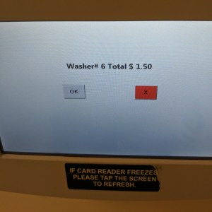 "a touchscreen menu that confirms the machine type and number, with a small ""ok"" button on the left hand side"
