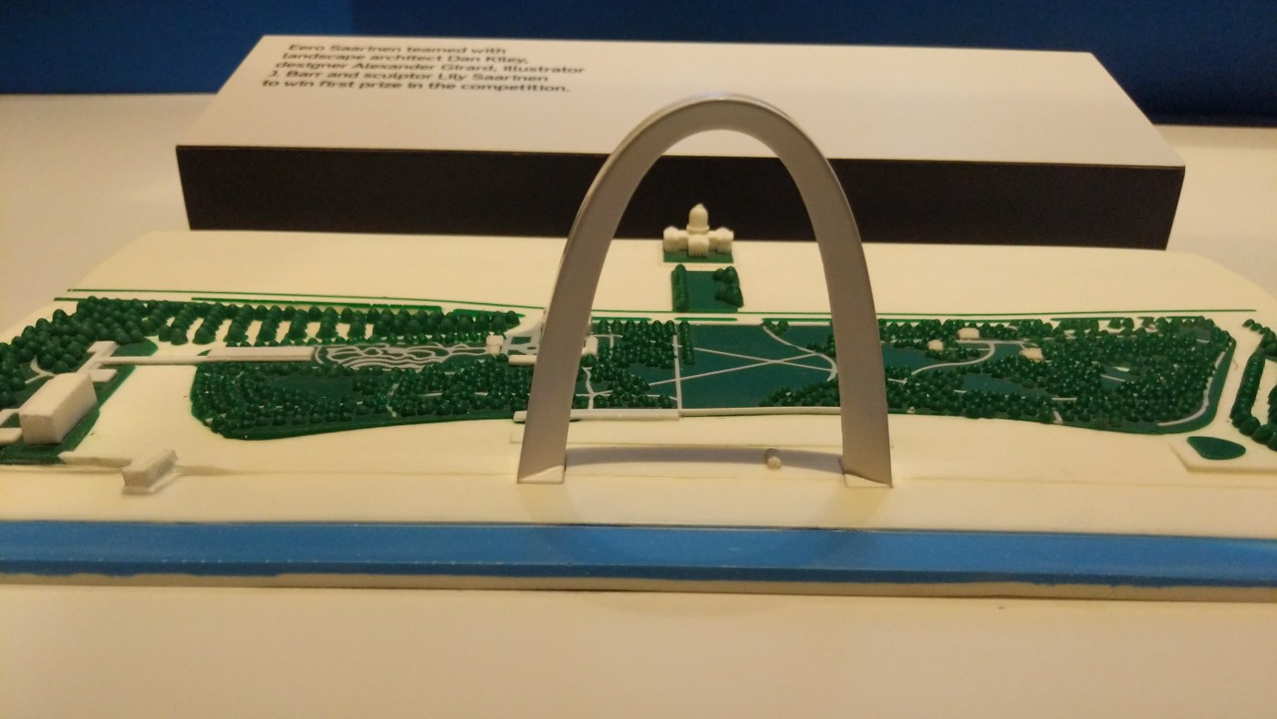 tactile map of the Gateway arch grounds with the arch extended above the grounds
