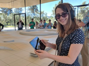 Veronica skiling and holding an iPad using augmented reality and wearing headphones