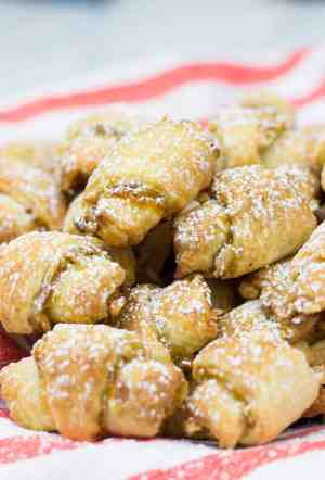 Apricot and Walnut Rugelach recipe is a perfect treat for the holiday season. These bite-size cookies are packed with apricot jam and chopped walnuts, and are very easy to make
