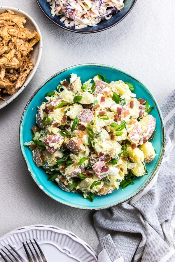 Creamy Potato Salad with Bacon and Eggs is an easy recipe that is perfect for any summer BBQ cookout.