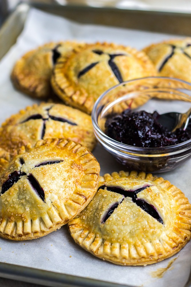 Mini Blueberry Hand Pies made with pie crust and homemade blueberry jam is a perfect treat for breakfast or dessert.