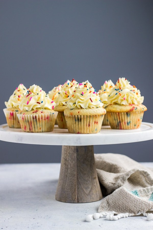 Birthday Cake Funfetti Cupcakes topped with delicious vanilla buttercream frosting and lots of sprinkles!