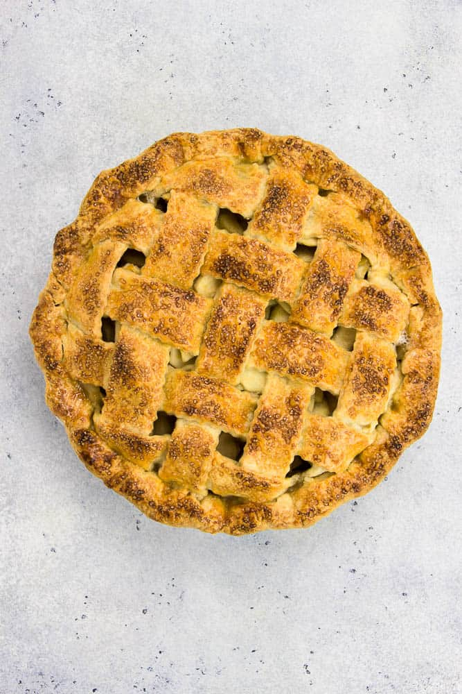 Classic Apple Pie made with foolproof pie dough and cinnamon apple pie filling, topped with a lattice pattern is the best dessert recipe for the holiday season!