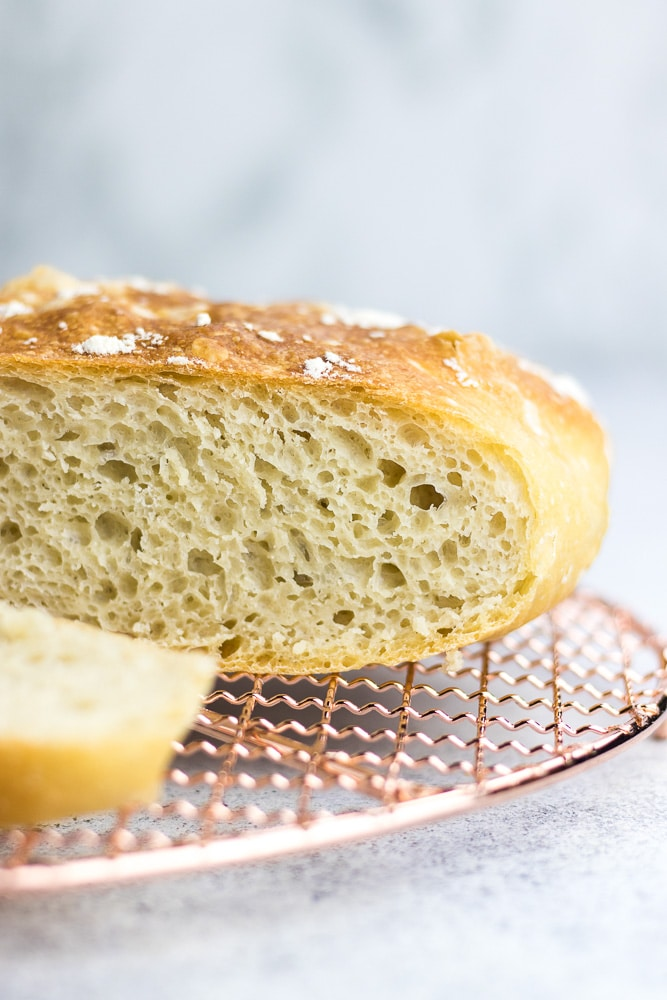 No-knead bread baked in a dutch oven is the easiest bread recipe you can find. Made with only 4 ingredients, this bread is perfectly soft and airy inside and has a beautiful outside crust.