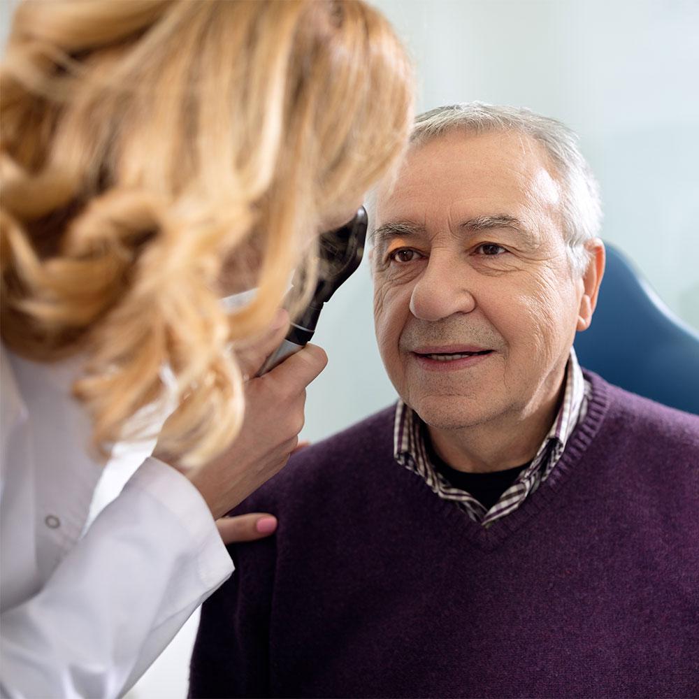 Older man receiving eye exam