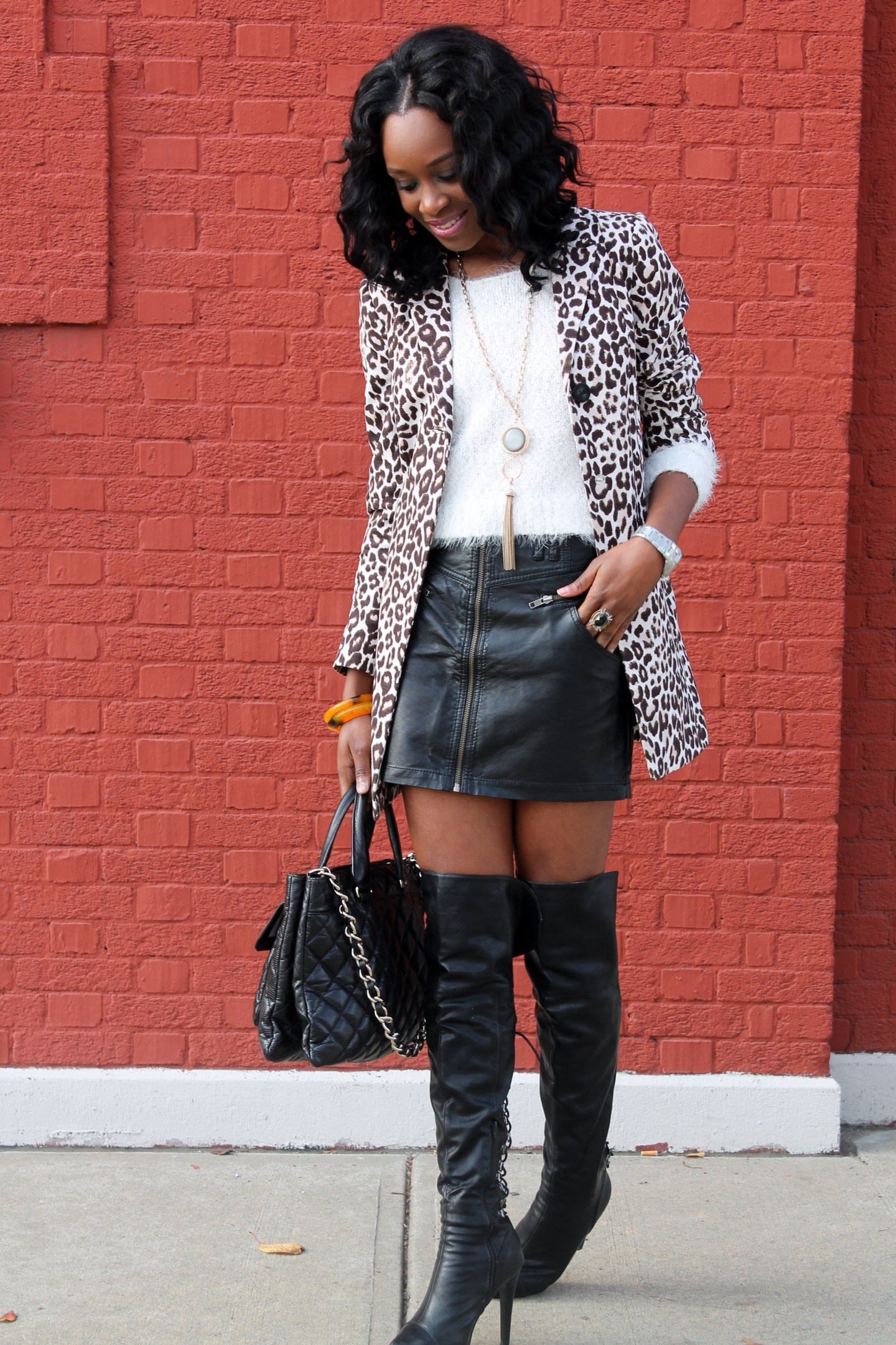leather skirt over the knee boots and leopard coat