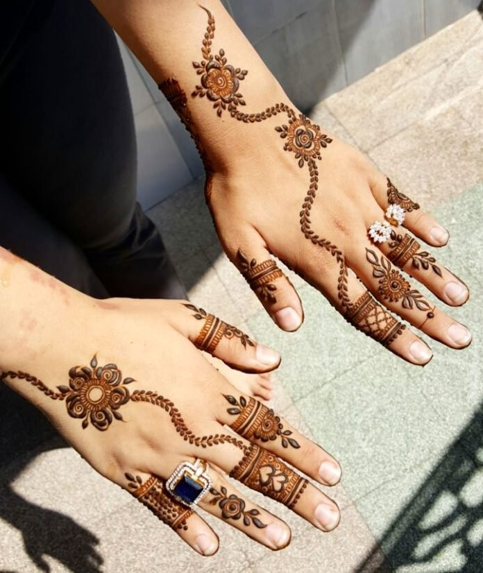 Leafy trails and intricate patterns on fingers Arabic Mehndi 8