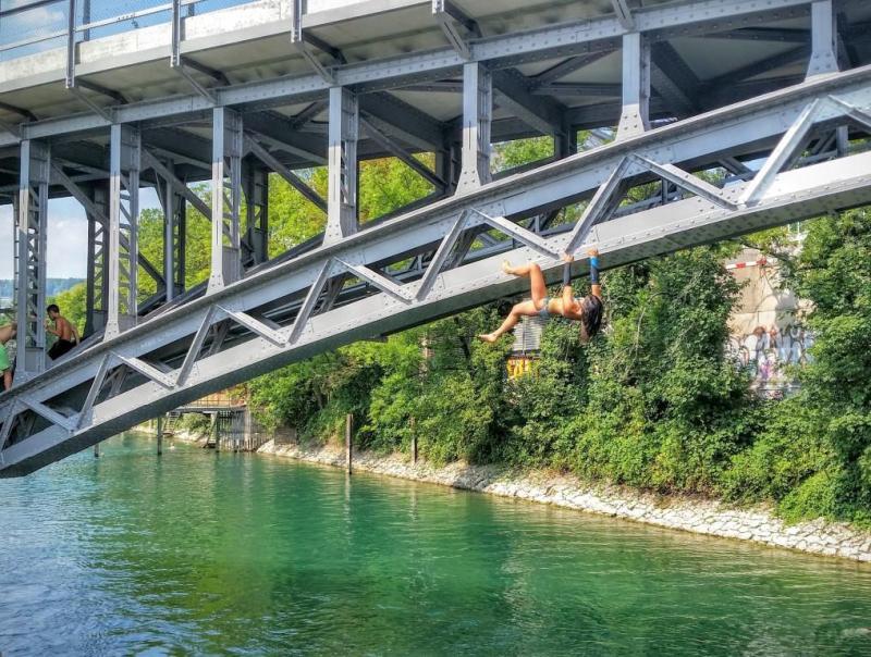 Alannah Yip Buildering on bridge