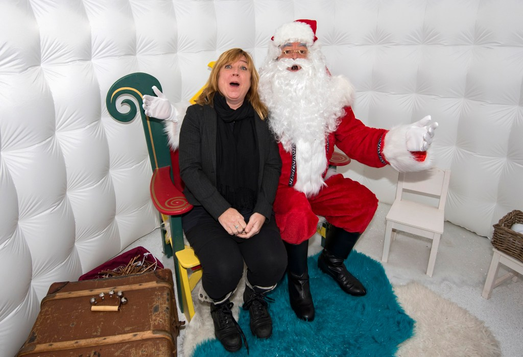 Susi form Vervate sits on Santas knee