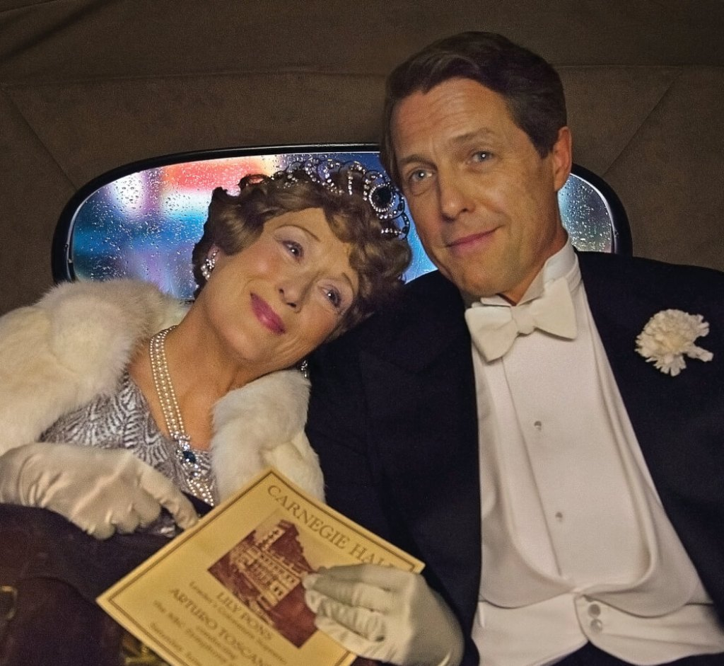 Florence Foster Jenkins (Meryl Streep) and St. Clair Bayfield (Hugh Grant) in a scene from FLORENCE FOSTER JENKINS, directed by Stephen Frears. An Entertainment One Films release. For more information contact Claire Fromm: cfromm@entonegroup.com