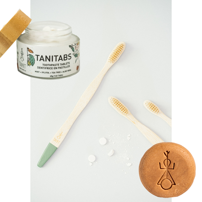 Zero waste kit by Tanit, including toothpaste tablet, bamboo toothbrush, and solid shampoo.