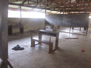 A class  serving over 50 students with just one chair and table
