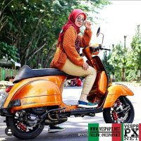 Vespa girl on metallic orange bronze Vespa PX custom modified with Vespa sprint wheel . hashtag and mention @vespapxnet for feature repost Check website www.vespapx.net for more