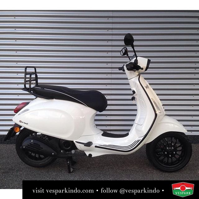 Featuring a very neat vespa sprint white with black styling by collections2wielers