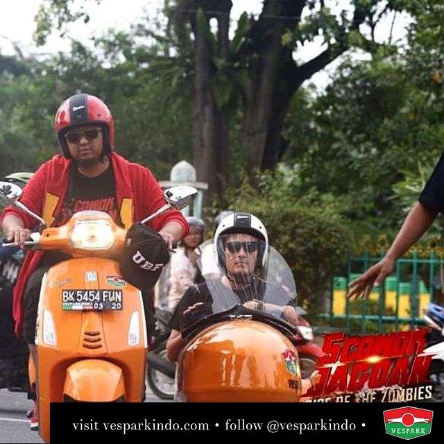 Vespa sidecar riding adult