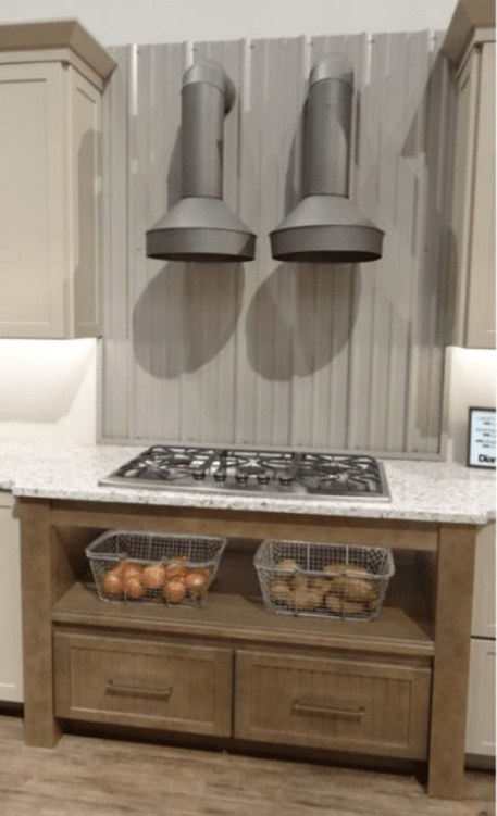 Double up on your hood to add interest to your kitchen designs.