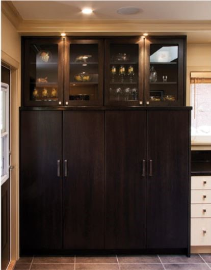 Mid height tall units with shallow glass doors above reduce bulk of these units
