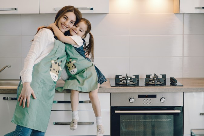 mother and daughter making memories in their new kitchen