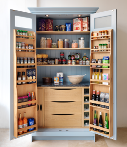 pantry with condiment storage shelves on cabinet doors