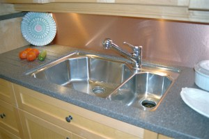 stainless steel sink in angled design under mounted