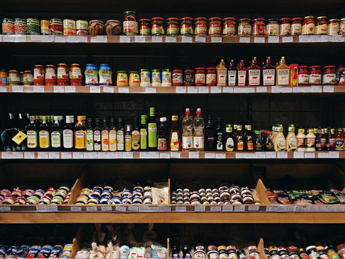 Grocery shelf full of condiments