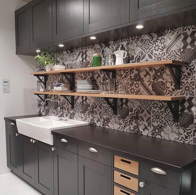 patterned backsplash tile behind wood floating shelves