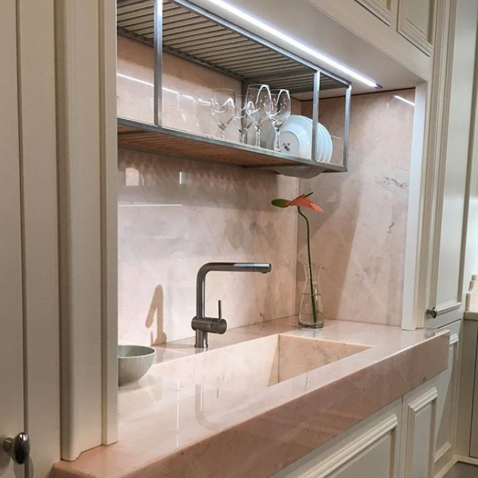 metal shelf above sink for draining dishware