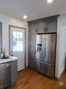 renovated kitchen's food storage zone with refrigerator and pantry