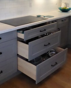 custom drawer placed under cooktop