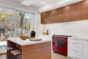Two toned cabinets with red range