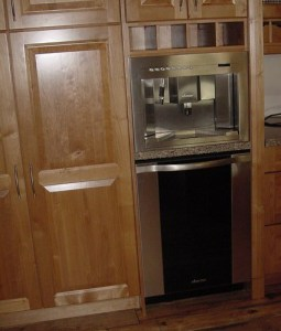 dishwasher installed under a built in coffee maker