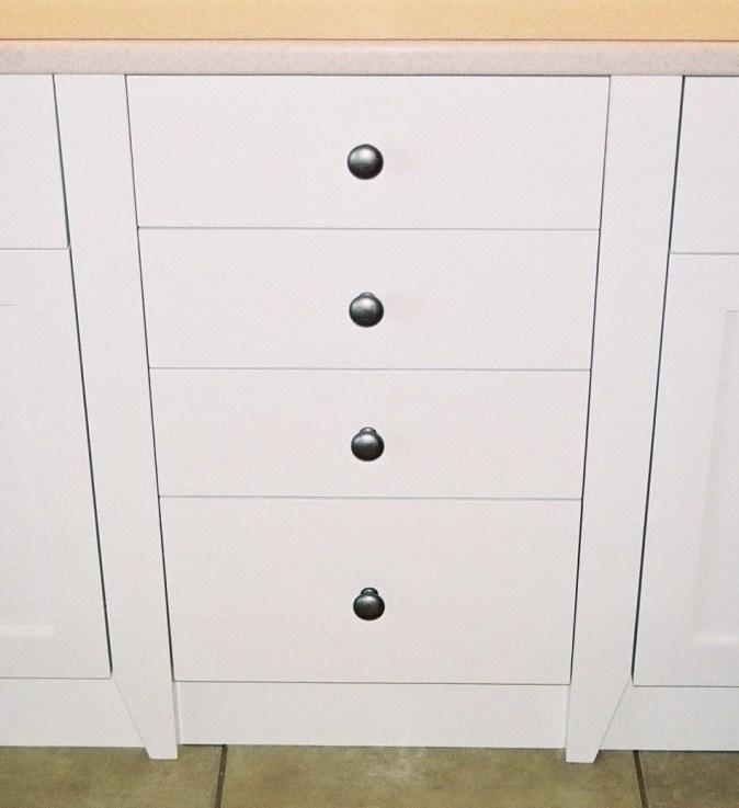 pilasters beside base drawer bank
