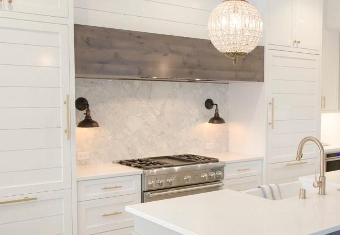 Modern farmhouse kitchen with quartz slab in backsplash