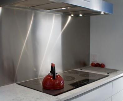 stainless steel backsplash used behind a cooktop