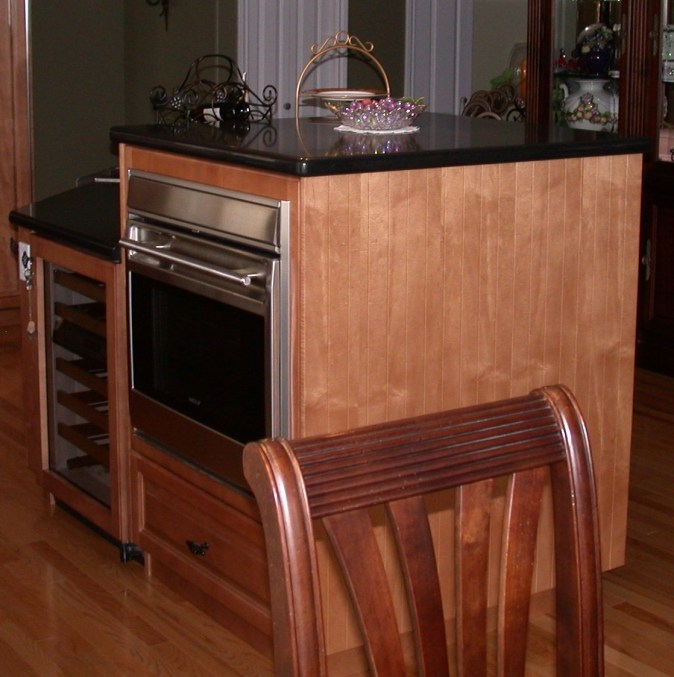 raised base oven cabinet on island