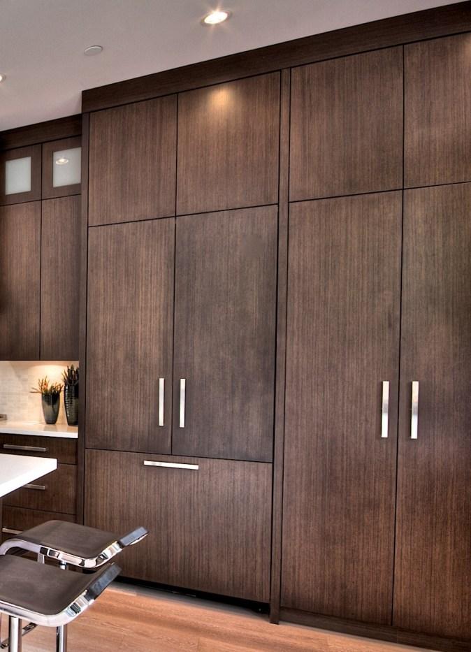 dark wood paneled fridge and pantry