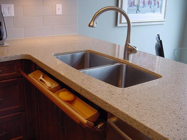 Under mount sink with storage tilt fronts